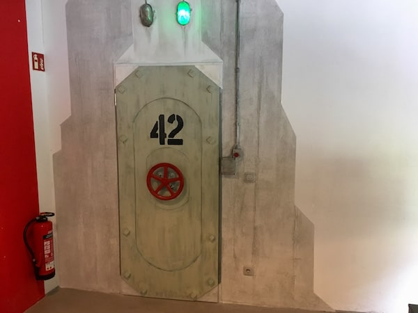 The entry to the game, a steel door labeled 42 with a red wheel.