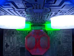 In-game: Closeup of a large circuit board with multiple glowing LEDs.