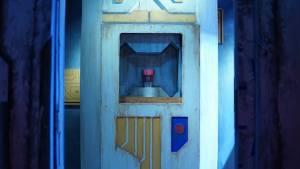 In-game: A storage device with a red object within it.