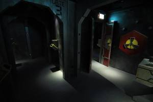 In-game: A series of chambers, a radiation symbol on the wall.
