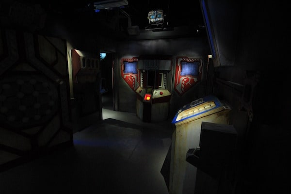 In-game: Wide angle shot of a control room.