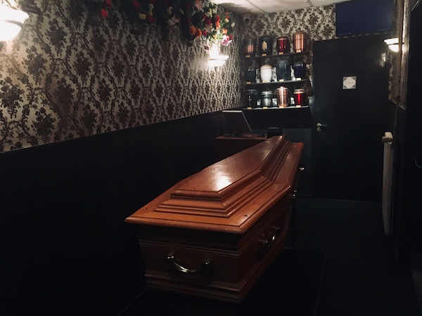 In-game: a casket in a funeral parlor.