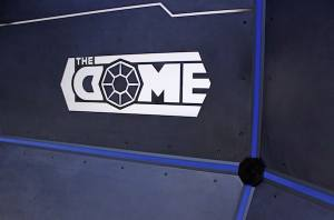 In-game: The Dome's logo glowing on a steel wall.