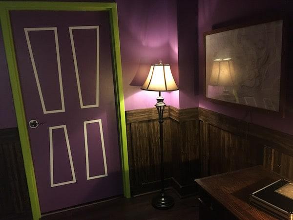 In-game: A cartoonish purple and green door.