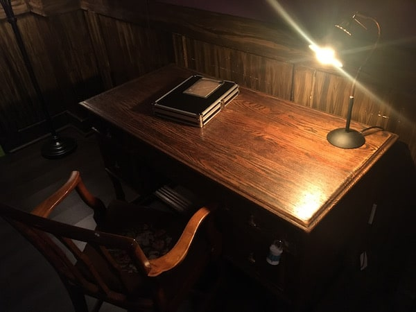 In-game: A wooden desk with locks on the drawers.