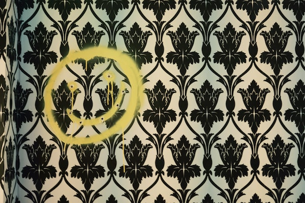 A smiley face spray painted and shot into the wall of 221B Baker Street.