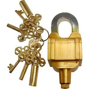 A large and sturdy brass padlock beside 6 strange brass keys.