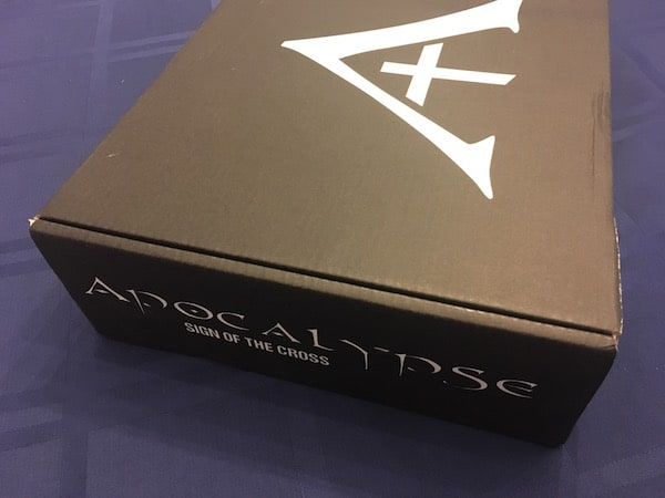 The box for Apocalypse Sign of the Cross.