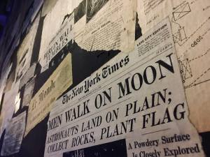 In-game: A wall of newspaper clippings, the NY Times piece about Apollo 11 in focus.