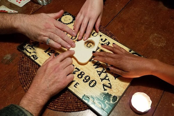 4 hands on a ouiji board.