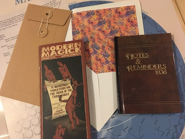 "An assortment of items including a journal from 1936 and a pamphlet titled ""Modern Magick."""
