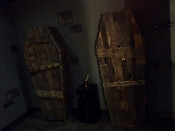 In-game: A pair of old, worn coffins leaning against the wall.