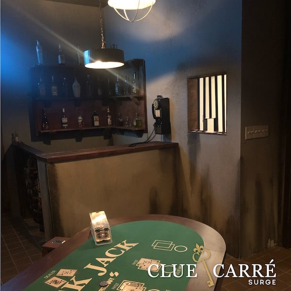In-game: A bar beside a blackjack table in a back room casino.