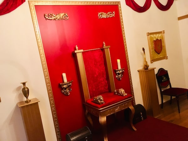 In-game: A red and gold throne room.