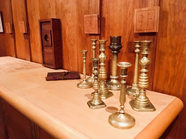 In-game: A collection of candle sticks on a table.