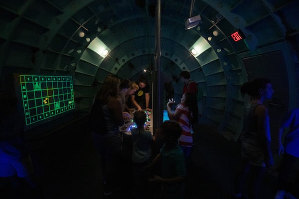 In-game: a group solving inside of the submarine.