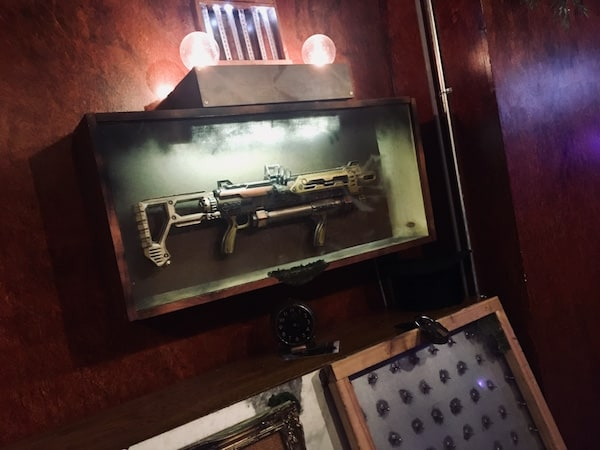 In-game: a large steampunk gun mounted to the wall.