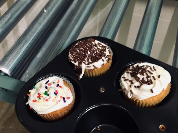 In-game: 3 decorated cupcakes in a baking pan.