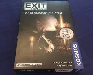 Exit: The Game Catacombs of Horror box art featuring a skull, and lit candle.