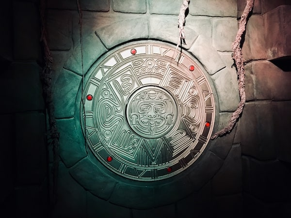 In-game: A gold Mayan sculputre engraved and hanging from the wall of the tomb.