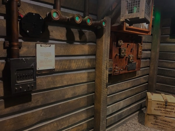 In-game: an assortment of mechaical controls mounted to the wall of a mine.