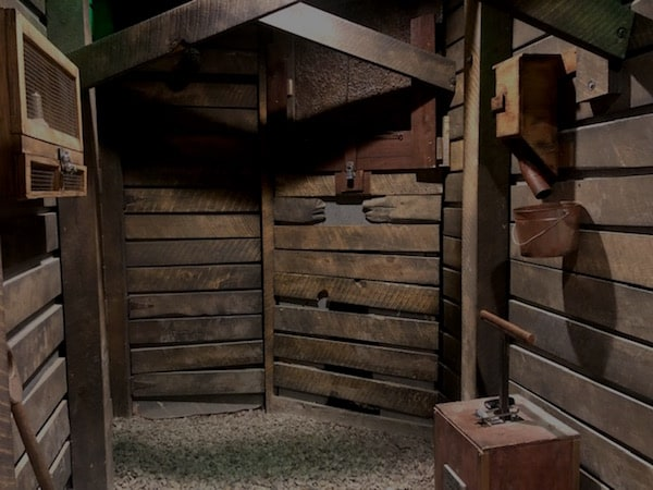 In-game: a wood walled mine with a TNT detinator.