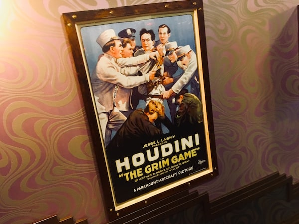 "In-game: a poster advertising Houdini's ""The Grim Game."""