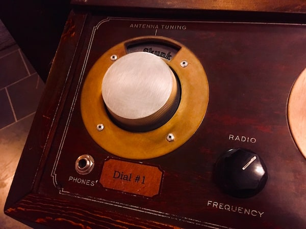 In-game: Closeup of a control panel with a few dials.