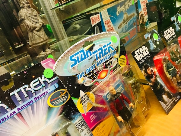 In-game: Closeup of Star Trek and Star Wars action figures.