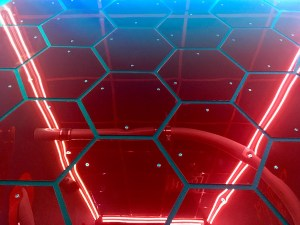In-game: A reflective wall of red hexagons.