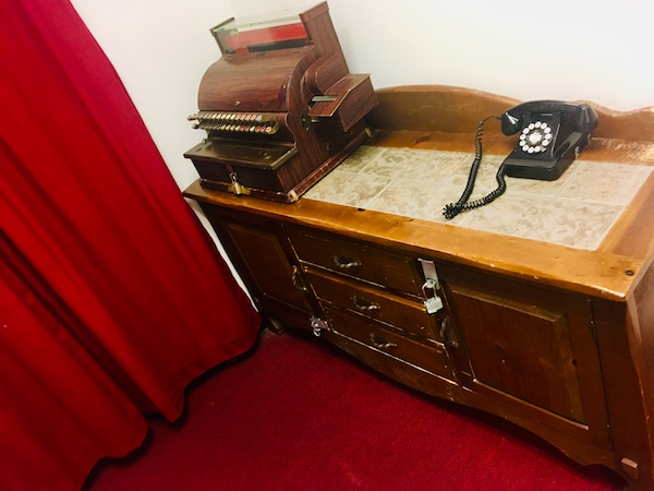 In-game: an antique cash register on a tabletop.