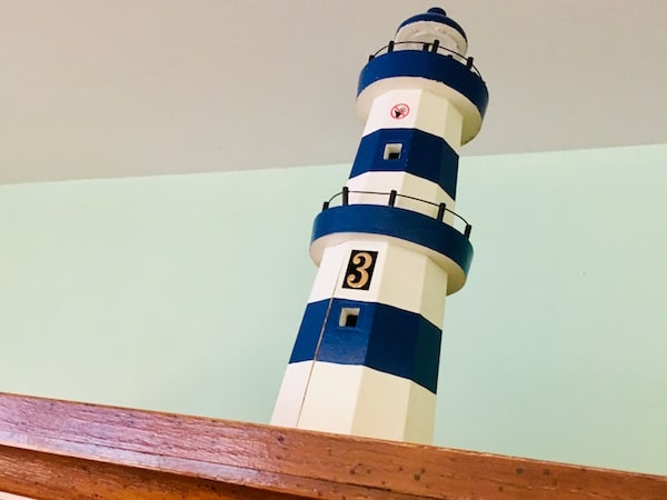 In-game: closeup of a lighthouse model with a #3 on it.