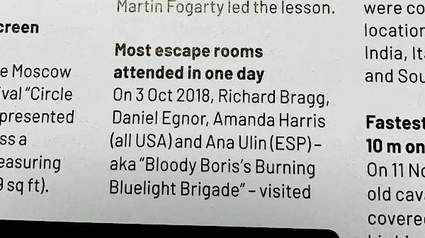 "Part one of the print entry reads: ""Most escape rooms attended in one day. On 3 Oct 2018, Richard Bragg, Daniel Egnor, Amanda Harris (all USA) and Ana Ulin (ESP) - aka ""Bloody Boris's Burning Bluelight Brigade"" - visited"""