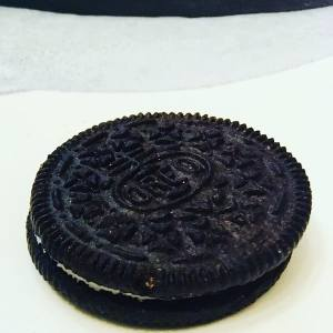 Closeup of a whole oreo on a plate.