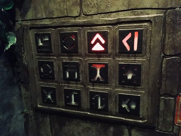 In-game: A set of stone symbols arranged in a 3 by 4 grid, one symbol glows red.
