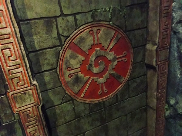 In-game: Closeup of a doorway with a large symbol carved into the stone.