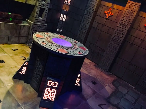 In-game: a large stone alter in the middle of a temple. A blue light glows from the center of the alter.