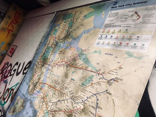 In-game: A NYC subway map mounted to the subway wall.