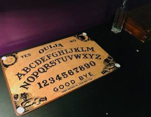 In-game: a Ouija board on a desk.