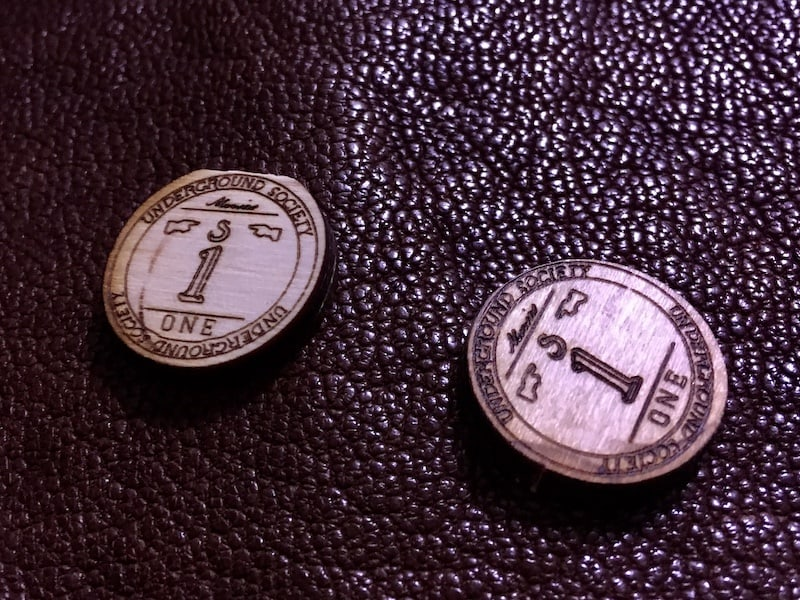 Closeup of two drink tokens.