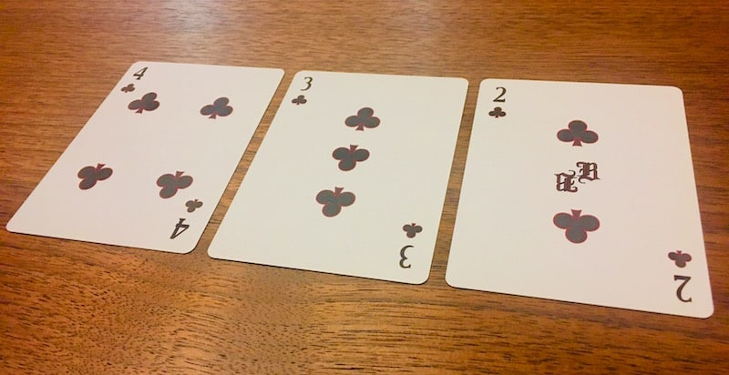 """The 2, 3, & 4 of Clubs from Carte Rouge. They look normal except for an """"R"""" printed in the middle of the 2."""