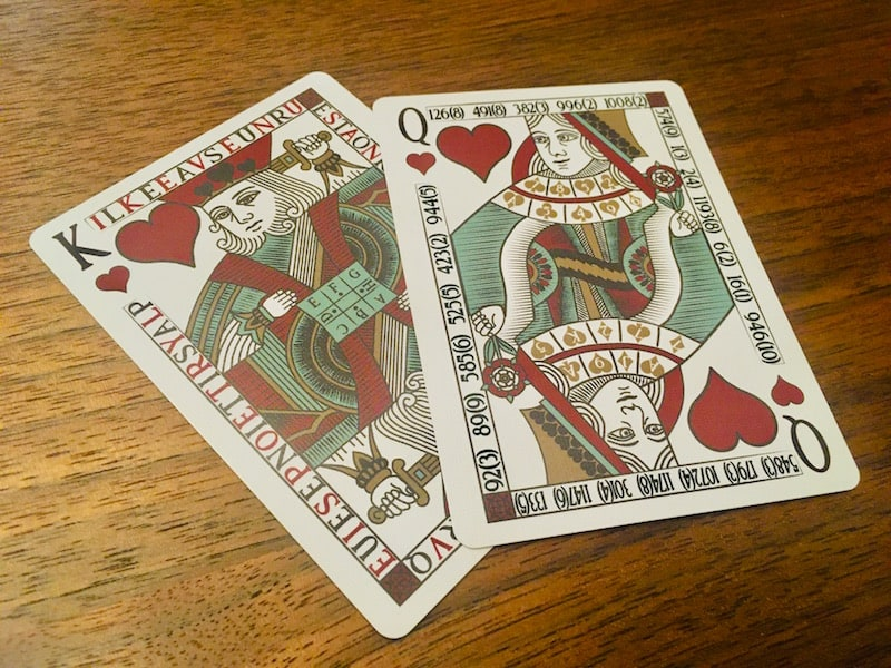 The King and Queen of Hearts from Carte Rouge. Both have clearly have ciphered messages around the boarders and on their clothes.