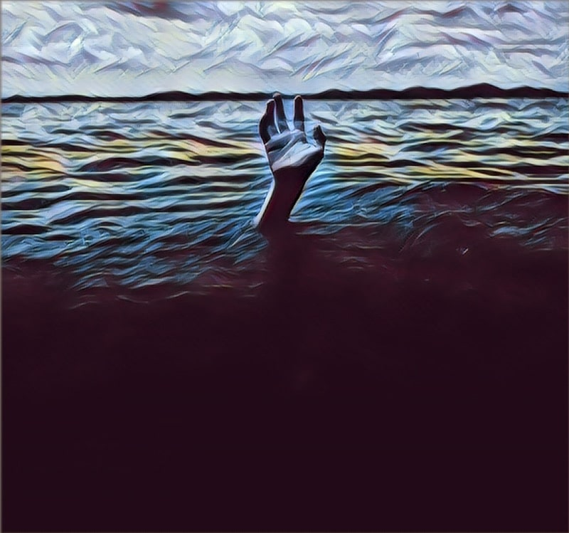 A hand reaching up out of dark waters.