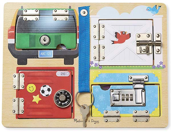 A child's latch board with a keyed lock, a gate latch, a combination lock, and a briefcase lock.