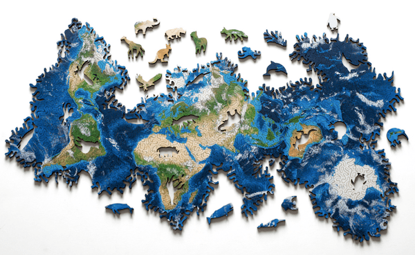 A laser cut wooden jigsaw puzzle of the eather that has no beginning or end.