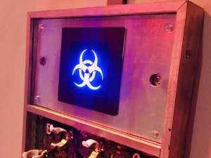 In-game: A piece of machinery with an illuminated blue biohazard symbol.
