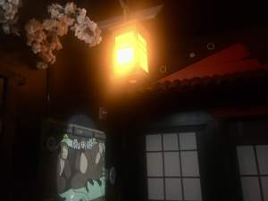In-game: a lantern hung outside of a japanese building.