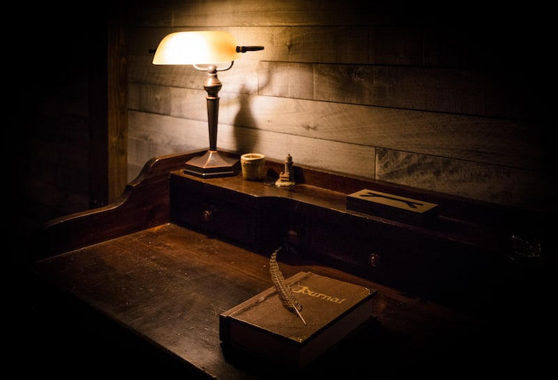 In-game: A beautiful old writer's desk with a journal and a quill pen.