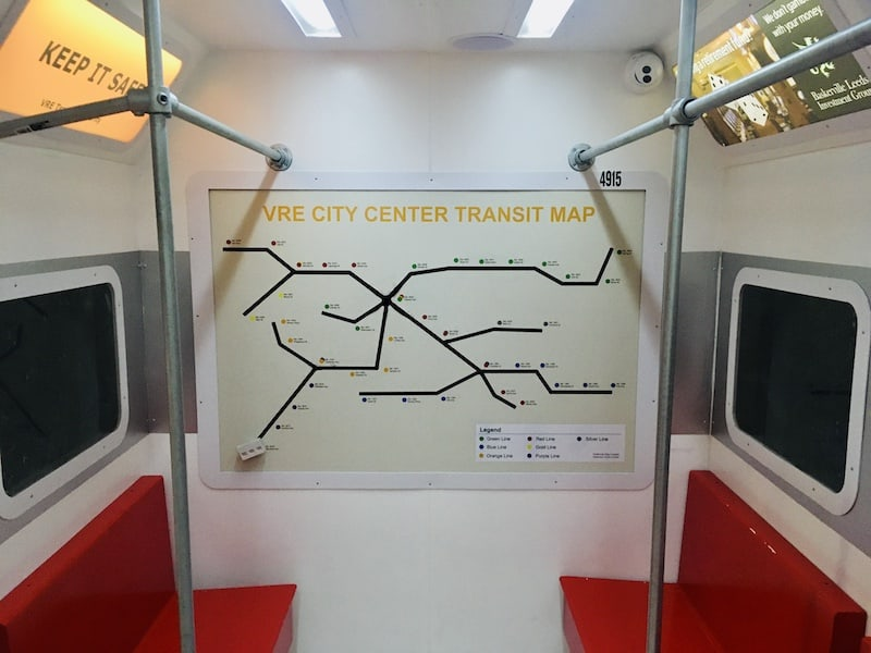 In-game: A subway map along the back wall of the train car.
