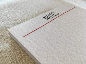 "A large notepad that says ""Notes"" at the top."